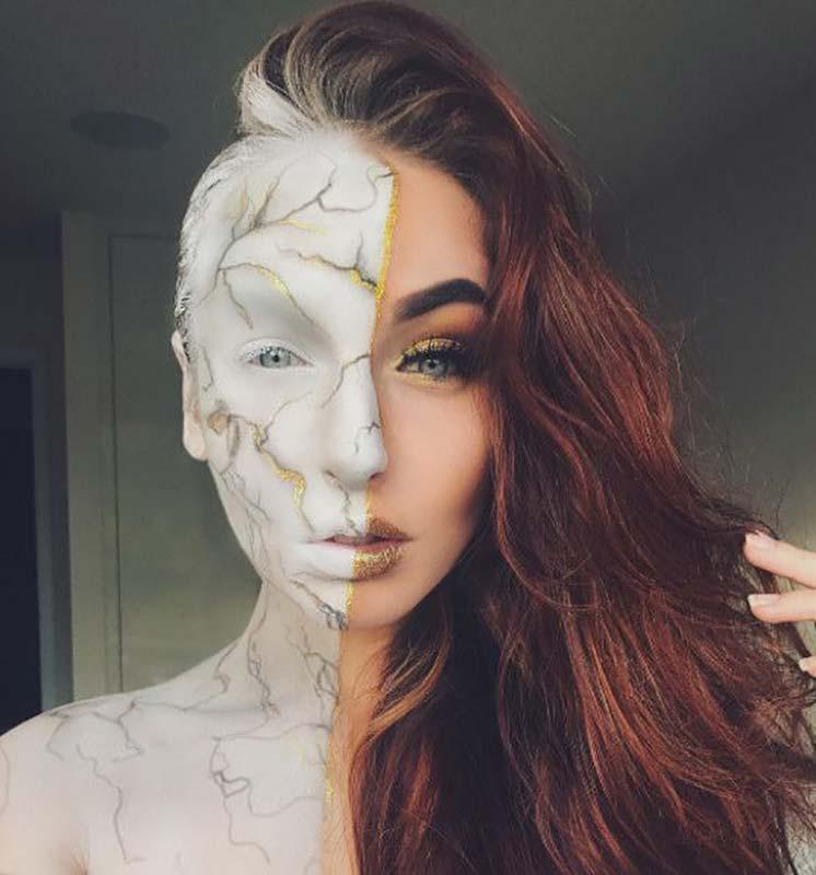 مدل آرایش هالووین یک خانم که نیمی از صورت خود را مثل مجسمه مرمری کرده است