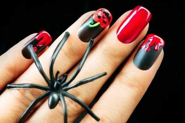 مدل طراحی ناخن قرمز و مشکی کدو تنبل برای هالووین