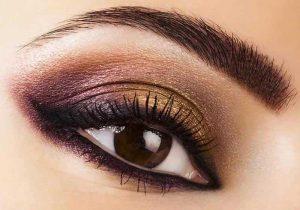آرایش چشم تیره مشکی و طلایی